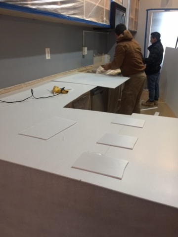 The template gets taken with the new faucet and sink so that the corian counter can be cut to the proper size.