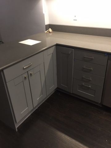 New kitchen cabinet hardware was installed on all doors and drawers after painting of the cabinets was completed.