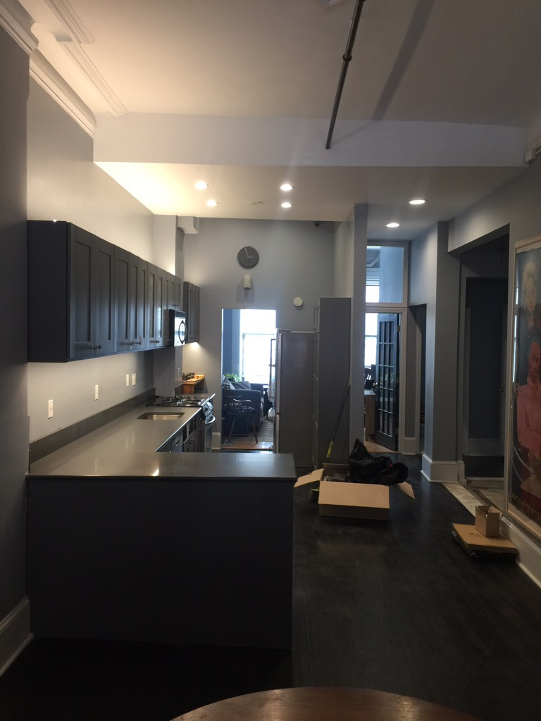 This is a completed kitchen makeover in a manhattan townhouse that that had the cabinets painted, counters replaced, new lights installed and sink replaced.